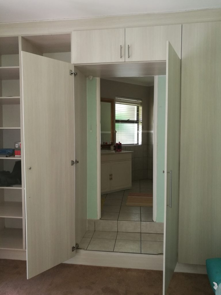 'Laracina' Melamine doors with bathroom access behind