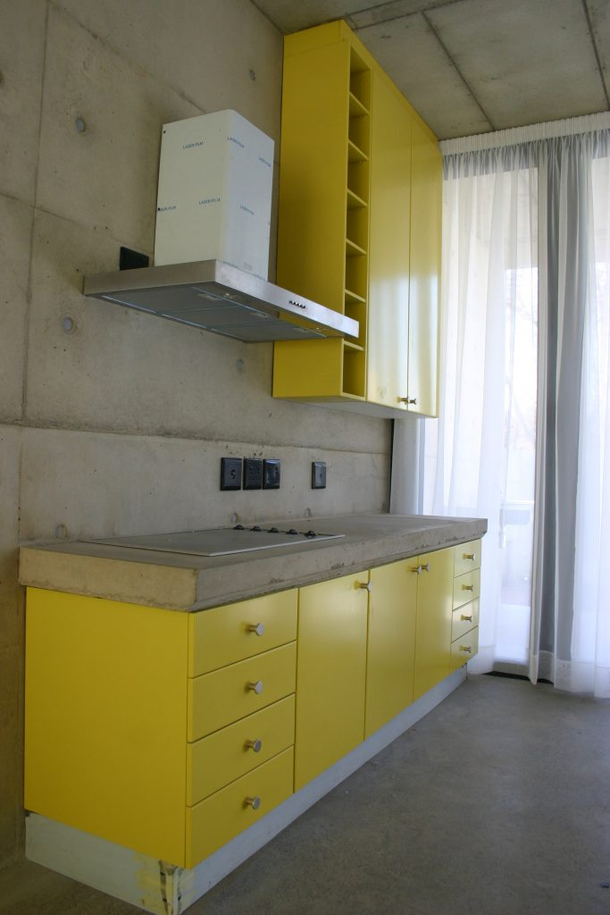 Sprayed yellow doors with concrete counter