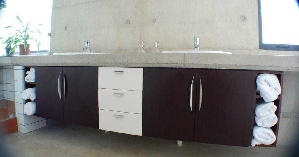 Two tone:  Vanilla and Mahogany wrap doors with concrete counter