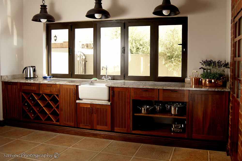 Kitchen solid mahogany farmstyle doors with juperana granite