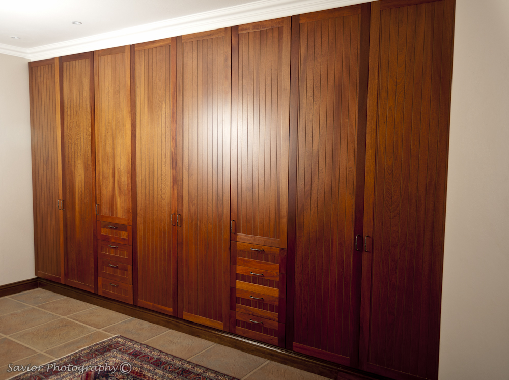 Wall to wall cupboard with solid Mahogany farmstyle doors