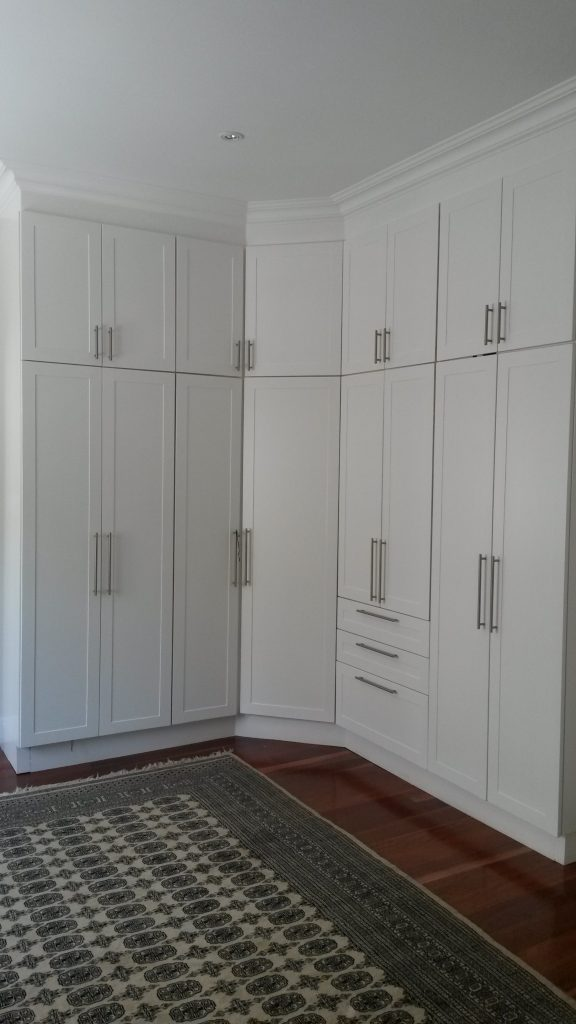 Hand painted shaker doors with space for TV and multiple drawers