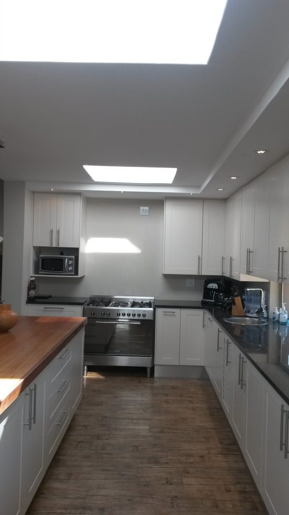 White sprayed doors with Rustenberg granite and solid Saligna work tops