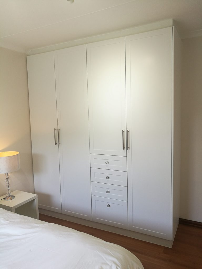 Satin white shaker wrap doors with multiple drawers