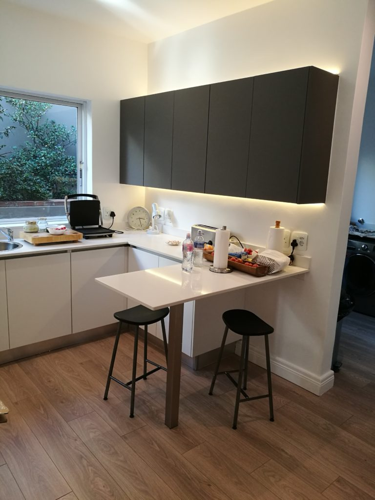 Storm Grey/White  combo Acrylic doors with Speckle Quartz work tops