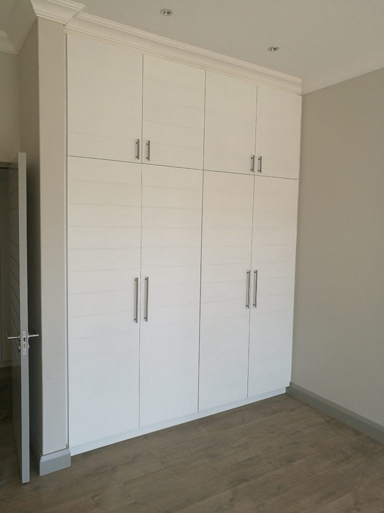 Hand painted T & G doors with horizontal groove