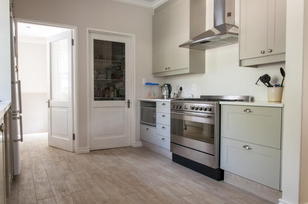 light grey sprayed shaker doors with solid Saligna worktop